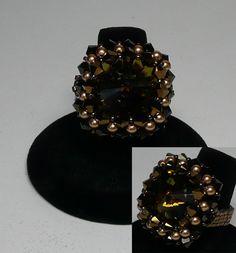 Riva Tabac  Design by Pencio   Swarovski Tabac Rivoli with Dorado 2X and Jet Nut bicones with Bronze pearls with fire polished and miyuki beads