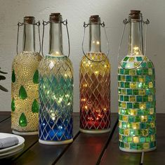 Best DIY Ideas and Designs of Wine Bottle Craft - Live Enhanced bottle crafts lights Wine Bottle Craft Ideas Old Liquor Bottles, Liquor Bottle Crafts, Wine Bottle Art, Lighted Wine Bottles, Diy Bottle, Bottle Lights, Wine Bottle Lanterns, Beer Bottle, Diy Projects With Wine Bottles