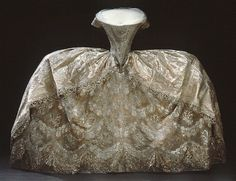 Wedding Dress: 1774, embroidered and brocaded silk, elaborately trimmed. Belonged to the Duchess Hedvig Elisabeth Charlotta of Sweden (crowned Queen in 1809).