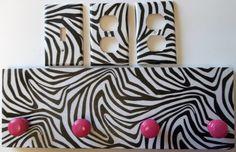 For the tween's room: Zebra Stripe Print Pink White Coat Rack & Light Switch Outlet SET Wall Decor. $19.99, via Etsy.