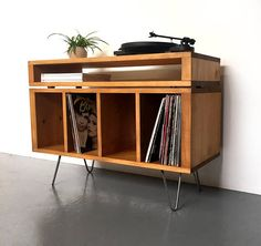 This design will be ready to dispatch in about 2 weeks from order. This versatile solid wood cabinet is designed to be used as a TV stand, a vinyl record storage and media table, a sideboard or even a cocktail cabinet. The lower component has 4 compartments of 32cm high (13), ideal for