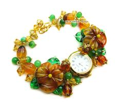 `Янтарь` наручные часы с бусинами лэмпворк. Часики со стеклянными анютиными глазками    Подробнее о том, как заказать товар, Вы можете узнать в правилах магазина www.livemaster.