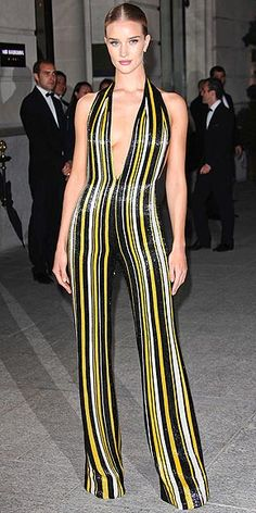 ROSIE HUNTINGTON-WHITELEY After walking the Balmain runway, Rosie takes advantage of one of the perks of being a supermodel, nabbing a sequined, striped jumpsuit by the brand for the CR Fashion Book Issue Nº5 launch party during Paris Fashion Week.
