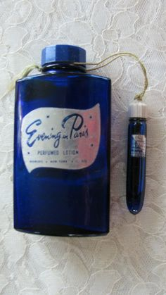 Vintage EVENING IN PARIS COBALT BLUE PERFUME BOTTLE & LOTION BOTH HALF FULL