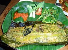 Pepes ikan mas, steamed goldfish in banana leaves wraps with herbs (West Java)