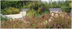 The QEF Garden for Joy by Heather Appleton is a case in point.This is a soft garden based on circles and filled with flowers.