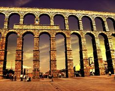 Segovia, Spain. this huge aqueduct is hand built with no cement to hold it up, Mow thats construction