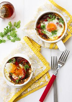 Shakshuka - Moroccan spiced onions, peppers and tomato with poached eggs.