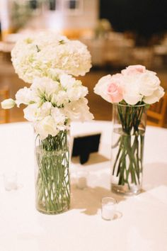Not sure how to decorate your reception tables? Three small vases of flowers always make pretty centerpiece! Captured by Ashley Monogue Photography #bridesofnorthtx #wedding #centerpiece