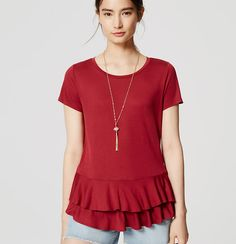 A tiered peplum hem adds a double dose of charm to this fresh summer love. Round neck. Short sleeves.