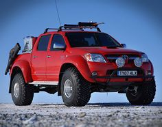 Top Gear Toyota Hilux    ...because its got a mounted rifle in case of polar bears and a water supply that's got a little vodka so it doesn't freeze.