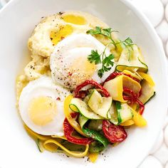 A pair of tender poached eggs settles into a nest of creamy Parmesan polenta in this Polenta with Eggs and Zucchini recipe. More egg recipes: http://www.bhg.com/recipes/breakfast/brunch/egg-recipe-ideas-for-brunch/ #myplate