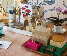 Stylist Rebecca Robertson organized this desk and loves how decorative trays instantly make random objects feel unified.