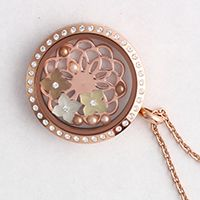 A Rose Gold Linkable Locket with Crystals is filled with a Rose Gold Flower Screen, Mint Pearl, Sunflower and Golden Pearl Frosted flowers with both Cream Rose and Vintage Gold Pearls.
