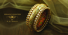 Be eclipsed by the splendour emitted by our marvellous jewellery creations. This enchanting bangle has been decorated all over with polki and has a smattering of luminous pears crafted on both its edges. But what enhances the grace of this piece is the gorgeous meenakari done on the underside of the bangle. Can't take your eyes off it, can you?! You can comment below or inbox us to inquire about the price and other details. #KKJewels #Jewellery #Ahmedabad #heritagejewellery…
