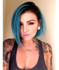 Miss having turquoise color hair