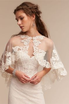 Adorlee Cape in Bride Bridal Cover Ups Explore the trend of Bridal capes and capletes! We've spotted 20 fab bridal capes and capeletes that are currently making our bridal hearts sing for joy. Covering up never looked so chic with wedding boleros, wraps, Wedding Cape, Bridal Cape, Wedding Attire, Wedding Bride, Wedding Gowns, Wedding Blog, Wedding Ideas, Lace Wedding, Filipiniana Wedding