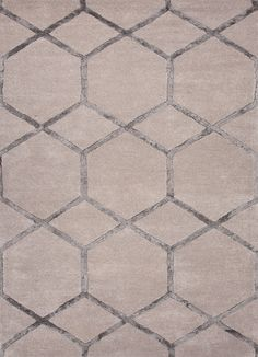 Tan rug with gray accent modern design.