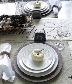 Modern Thanksgiving Tablescape — from AKA Design's. The entire modern-yet-traditional theme is pulled together using wood grain chargers with bright white dishes. Classy.