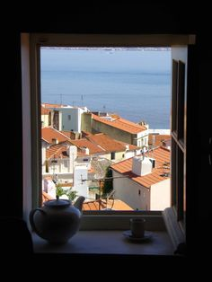 Alfama District - A window on Alfama! View on the majestic #Tagus river from our #Alfama apartment.