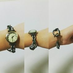 A watch that i made~  Anchor as a lock with dark brown, white a moss green band that i knotted together with a old syle watch~