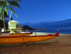 Waikiki beach outriggers with view of Diamond Head