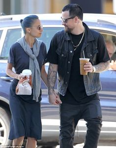 Honestly, I think these two are adorable... Look of love: Reunited couple Nicole Richie and Joel Madden linked hands and gazed into each other's eyes while on a romantic stroll in Brentwood