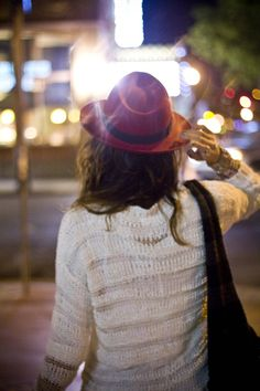red hat. white sweater.