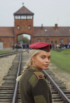 an Israel soldier stands outside of Auschwitz nazi concentration camp. Idf Women, Military Women, Mädchen In Uniform, Military Girl, Girls Uniforms, Real Women, Beautiful Women, Portrait, Photos