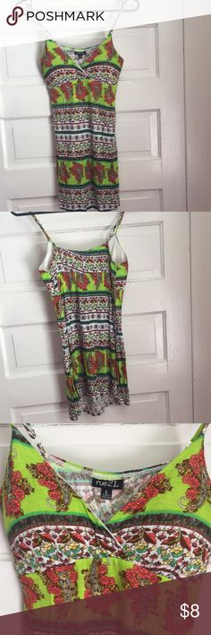 Rue 21 Floral Tank Top - Spaghetti Strap Rue 21 Floral Tank Top - Spaghetti Strap   Size - L  Adjustable straps  Padding in cup area (but not meant to have internal bra)  Long, flowy, light material Would look nice with dark pair of jeans   Only worn once (by my sister who took off the tag and wore without my permission, of course!) Rue21 Tops Tank Tops