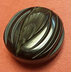 Check out this item in my Etsy shop https://www.etsy.com/listing/261947544/black-carved-bakelite-buttons
