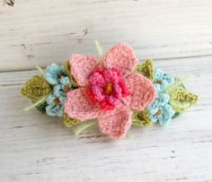A pretty crochet that could be used for many different things if you just be creative.  1. Can be a pin by attaching a bobby pin to it.  2. Can be sewn or attached to a headband.  3. Great clip for hair.
