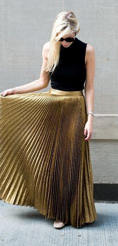 glitter pleated skirt + black sleeveless shirt                                                                             Source