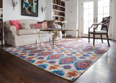 colorful rug   neutral couch