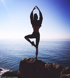 Ethereal: The supermodel shared several tranquil images along with her post including one of her performing the tree yoga pose on her website