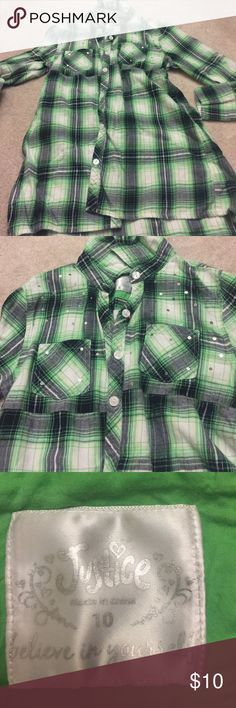 Green plaid button down Justice plaid tunic. Has silver sequins on chest area. Colors are green, white, black and silver. Elastic band inside gives a cute shape to the tunic! Justice Shirts & Tops Tees - Long Sleeve