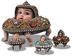 Mixed Media Artist Betsy Youngquist creates beaded sculpture. Mosaic covered creatures are encrusted with beadwork in Rockford, IL. Vintage doll parts.