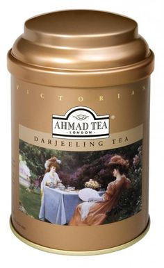 Ahmad Tea Darjeeling Tea (Victorian collection) tea tin ... gold coloured canister w/ artwork depicting Victorian women having tea in a garden at tea table under a tree, c. 2014, UK