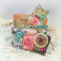 Mixed-media coffee sleeve album by Janelle Stollfus using Verve Stamps #vervestamps