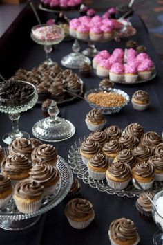 Wedding cupcake bar! Not this style or colors but LOVE the idea of having more than one flavor of cake to choose from so there's something for everyone!