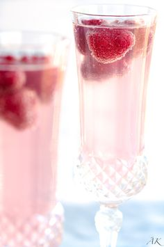 An elegant twist on the classic cocktail. Essential to any celebratory brunch; Bridal Shower, Mother\'s Day, or even just a Sunday! | aberdeenskitchen.com #raspberry #lemon #mimosas #brunch #drinks #cocktails #champagne #mothersday #shower