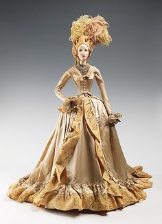 """1785 Doll"" with costume by Maggy Rouff, made in 1949 as part of the Friendship Train. This gown was inspired by a fashion plate from ""La Galerie des Modes"", which is credited as the first publication of fashion plates, printed by Parisians Jacques Esnauts and Michel Rapilly in 1778."