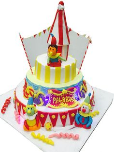 Birthday Cake Delivery In Mumbai Circus Themed Surrounded With Clowns And Decorated Triangle Flags Made Of Fondant