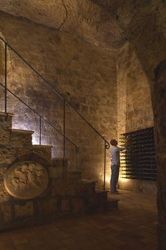 Wine cellar in a home in Civita di Bagnoregio, Italy designed by Studio F