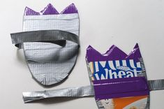 Make dinosaur feet out of a cereal box and duct tape
