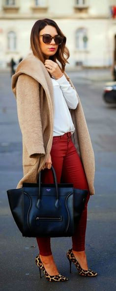 Shop this look on Lookastic:  http://lookastic.com/women/looks/long-sleeve-blouse-coat-skinny-jeans-tote-bag-pumps/8150  — White Long Sleeve Blouse  — Camel Coat  — Red Skinny Jeans  — Black Leather Tote Bag  — Brown Leopard Suede Pumps
