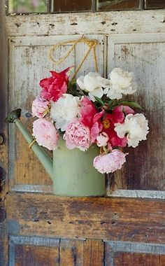 flowers in a watering can create an instant country chic look #color #gold canyon