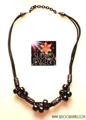 This Czech Glass with gunmetal can be worn by guy or gal! $35.00