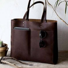 af60fe0605 The Handmade Leather Tote Holds Your Everyday Items in Style. Black Leather  BagsDark ...