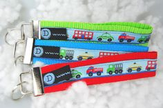 rotes Schlüsselband mit Fahrzeugen / Autos von DaiSign  http://de.dawanda.com/product/48838386-Schluesselband-Anhaenger---Feuerwehr-Laster-Taxi